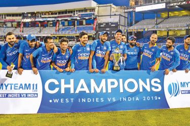 India's team celebrates with the trophy after winning the 3rd and final ODI match against West Indies at Queens Park Oval, Port of Spain, Trinidad and Tobago, on August 14. AFP