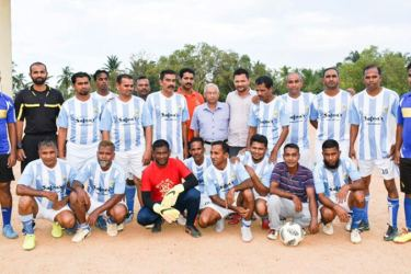 The South Eastern Soccer Masters football team with the guests.