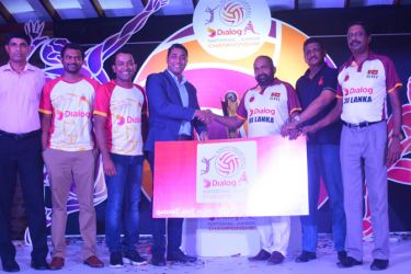 Senior General Manager Brand and Media, Dialog Axiata PLC handing over the sponsorship cheque to the President of Sri Lanka Volleyball Federation (SLVF) Ranjith Siyambalapitiya. Also in the picture are (from left) the Secretary of Tournament Organising Committee Dhanapala Jayapadma, singer Santhush Weeraman, Bhathiya Jayakody, Vice President of SLVF and DIG  R.M. Nimal Perera and General Secretary of SLVF A.S. Nalaka. (Picture by Ranjith Asanka)