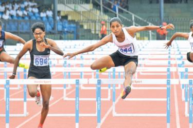 Lakshika Sugathi (third from left) who registered the best time after 23 years in the women's 100 metres Hurdles events