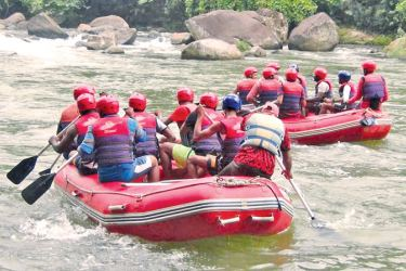 Foreign tourists rafting in Kitulgala.