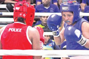 H.N.S. Thalgaspitiya (Unichela) who won the Bantam weight title at the 79th BASL Layton Cup Boxing meet in action during the semifinals at Royal MAS Arena on Friday. (Picture by Ruwan de Silva)