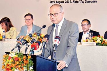 Ports, Shipping and Southern Development Minister Sagala Ratnayaka speaks at the launch, while National Policies and Economic Affairs Secretary V. Sivagnanasothy, UN Resident Coordinator Hanaa Singer, US Ambassador Alaina B. Teplitz, Highways and Road Development and Petroleum Resources Development Minister Kabir Hashim, and Central Bank Governor Indrajit Coomaraswamy look on.  Picture by Gayan Pushpika