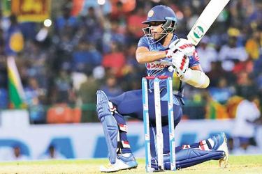Kusal Mendis who played a classy knock of 79 pulls for six during the first T20 international against New Zealand at Pallekele International Stadium yesterday. (Pix by Rukmal Gamage)