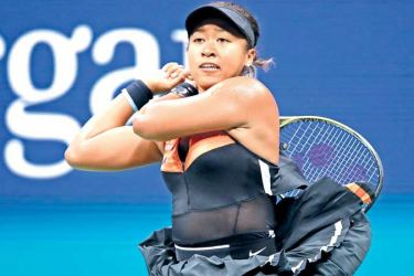 Naomi Osaka of Japan returns a shot during her Women's Singles third round match against Cori Gauff of the United States on day six of the 2019 US Open at the USTA Billie Jean King National Tennis Center on August 31, in New York City. AFP