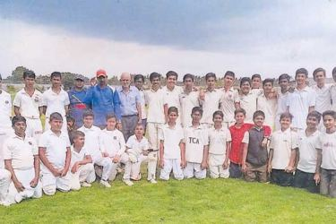 Under 14 cricket team of Gurukul Internatioal School, Hyderabad India and the touring Piliyandala Town Sports Club under 15 cricket team are seen here soon after the conclusion of the match. Standing sixth from left is former Centralian and the coach of the touring team Sriyan Chaminda. Picture by Dilwin Mendis Moratuwa Sports Special Correspondent