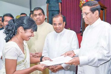 The awarding of Graduate Teaching Appointments in the Western Province was held under the patronage of President Maithripala Sirisena at the Sri Lanka Foundation Institute auditorium yesterday. A batch of 587 graduates who were among 15,000 candidates who sat the June 2019 teachers competitive examination received appointment letters from the President. Picture by Sandaruwan Amarasinghe- President's Media Division
