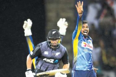 Sri Lanka's Wanindu Hasaranga traps New Zealand's Ross Taylor lbw for 48 in the first T20I played at Pallekele International Stadium on Sunday. Picture by Rukmal Gamage