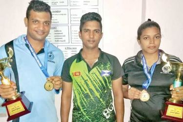 Best Boxers Gayan Prabath Rathnasiri and Kaushalya Perera with their coach Rusiru Indrajeewa (centre).