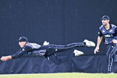 New Zealand's Mitchell Santner brings off a brilliant diving catch to dismiss Avishka Fernando for 37 in the second T20 international played at Pallekele International Stadium yesterday. (Pix by Rukmal Gamage)