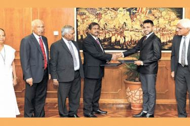 D M Rupasinghe, Director, FIU and Dulip Somirathna, Director General of NGJA exchanging the MOU.Dr. Indrajit Coomaraswamy, Governor of the Central Bank, H A Karunaratne, Deputy Governor of the Central Bank of Sri Lanka, S Gunaratne, Assistant Governor of the Central Bank of Sri Lanka and K D Chithrapala, Additional Secretary, Ministry of Industry and Commerce were also present.