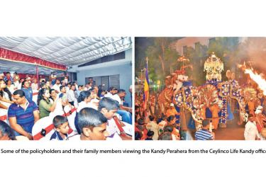Some of the policyholders and their family members viewing the Kandy Perahera from the Ceylinco Life Kandy office.