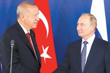 Turkish President Recep Tayyip Erdogan shakes hands with Russian President Vladimir Putin during a joint news conference following their talks on the sidelines of the MAKS 2019 International Aviation and Space Salon in Zhukovsky, outside Moscow on August 27.