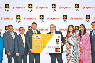 MD and CEO of Cargills Bank Rajendra Theagarajah and Director, CEO of Janashakthi Insurance Jude Fernando, at the launch of the Janashakthi-Cargills co-branded credit card. AGM Card Services  Mahesha Amarasuriya, Manager Card Operations Kaushi Fernanda and Manager Marketing  Renuka Hettiarachchi from Cargills Bank, along with GM Sales,  Harsha Abeywickrema, Head of IT K.V. Kuganathan, and Head of Marketing Manindri Bandaranayake from Janashakthi Life look on.
