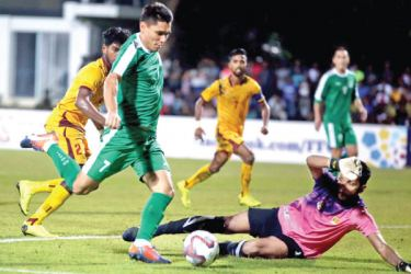 Turkmenistan's Orazasahedov Vahyt scoring their opening goal in the World Cup qualifier against Sri Lanka at Racecourse grounds in Colombo yesterday. Picture by Sulochana Gamage