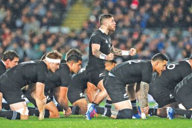 The All Blacks team warm-up for their game against Tonga.
