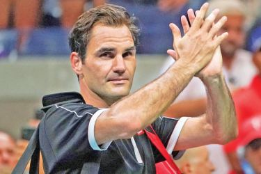Roger Federer salutes the Flushing Meadows crowd after losing to Grigor Dimitrov in the US Open quarter-finals.