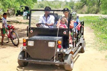 Sisira Kumara along with his family drives the jeep.