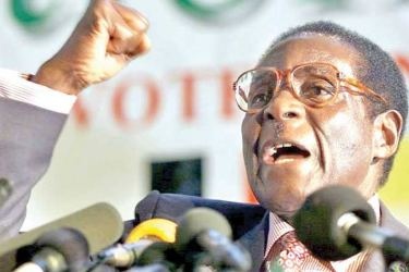 Zimbabwean President Robert Mugabe clenches his fist to salute Zanu PF comrades in Harare on May 3, 2000.