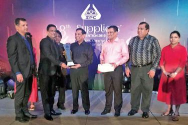 Astron Limited Deputy Managing Director - Sirimal Fernando (2nd from left) and Mahinda Jayasundara - Manager-Institutional Business receives an Award from Dr. Rajitha Senaratne - Minister of Health, Nutrition & Indigenous Medicine.