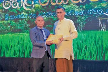 Chairman, Waters Edge, Chamath De Silva handing over the first copy of the 'Hela Rasaabhimaanaya' to Minister of Megapolis and Western Development, Patali Champika Ranawaka.