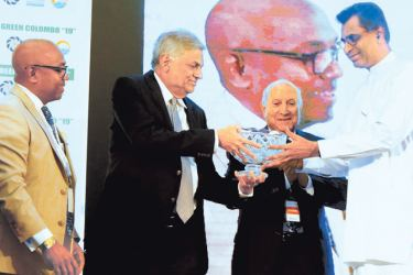 Prime Minister Ranil Wickremesinghe who was the Chief Guest at the inauguration of the 19th International Conference of the World Renewable Energy Congress (WREC) held at Hilton Colombo yesterday presenting a memento to Megapolis and Western Development Minister Patali Champika Ranawaka in appreciation of his services in developing the renewable energy sector. Picture by Hirantha Gunatilake