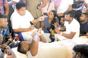 UNP Presidential candidate Minister Sajith Premadasa visited a group of disabled soldiers conducting a protest campaign opposite the Fort Railway Station and gave a patient hearing to their grievances yesterday. (Picture by Saman Sri Wedage)