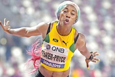 Jamaica's Shelly-Ann Fraser-Pryce wins the Women's 100m final at the 2019 IAAF World Athletics Championships at the Khalifa International Stadium in Doha on September 29, 2019.  (AFP)