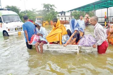 Patients being shifted after heavy monsoon rains in Patna, Bihar.