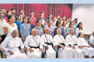 The new recipients, the undergraduates who are already receiving the grant, Founder of the De Mazenod Scholarship  Scheme Rev. Fr. Dennis  Iddamalgoda OMI, Rev. Frs. Rohan Silva (Former OMI Provincial of the Colombo Region), Justin Silva (Director Marian Grove- Kohuwala), Anjelo Wijewickrema of the Oblate Congregation and, Rev. Sisters Rani and Martin de Pores cum George Peiris of the HNB.