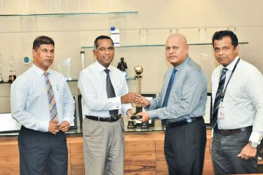 Anil Boudewyn, Sales Director of LMD (second from right) presents the award for the Most Respected Entities in Sri Lanka 2019 to Nanda Fernando, Managing Director of Sampath Bank PLC (second from left), flanked by Tharaka Ranwala, Senior DGM Consumer Banking (left) and Pujitha Rajapaksa, Chief Manager Marketing (right).