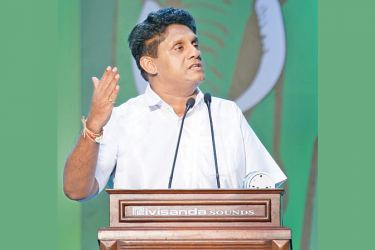 UNP Deputy Leader and Presidential candidate Sajith Premadasa addressing the Special Party Convention at the Sugathadasa Indoor Stadium yesterday.  Picture by Hirantha Gunathilake