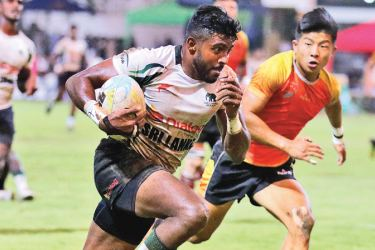 Sri Lanka captain Dansha Dayan on his way to score a try against China in the final leg of the Asia Sevens Series at Racecourse Stadium on Sunday.
