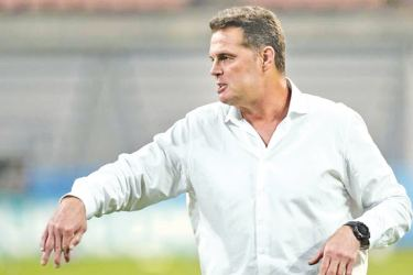 South Africa head coach Rassie Erasmus gestures during the warm up before the match