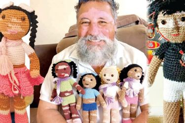 João Stanganelli Jr. with some of the dolls he had made