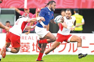 France's wing Alivereti Raka runs with the ball  during the 2019 Rugby World Cup Pool C match between France and Tonga at the Kumamoto Stadium in Kumamoto on October 6. AFP