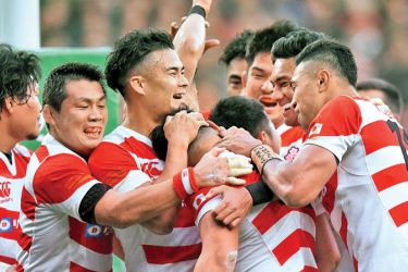 Japan's Ryoto Nakamura celebrates scoring their first try with team mates.