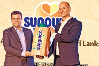 President, CO-RO A/S Denmark Soren Holm Jensen  handing over  Sunquick RTD dummy pack to Director, Sunquick Lanka Mangala Perera. Pictures by Sudath Malaweera