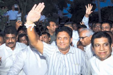 UNP Deputy Leader and Minister Sajith Premadasa, waves to supporters after he is named as the Presidential candidate of the New Democratic Front (NDF) recently. Picture by Hirantha Gunathilaka