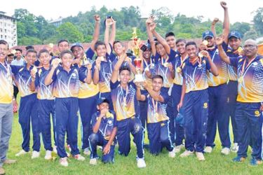 The Kandy Sussex College team with the principal and coach.