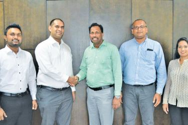 AIA and DirectPay officials exchange the MoU.