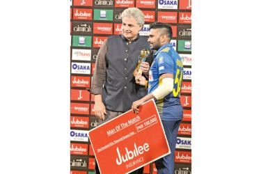 Man of the Match Bhanuka Rajapaksa receiving his award at the end of the second T20I against Pakistan at Lahore.
