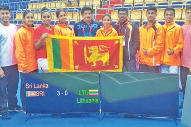 Sri Lanka shuttlers after beating Lithuania 3-0 to advance to 25-26th play off match.