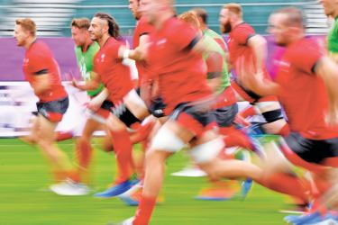 Wales' players take part in the captain's run training session at Oita stadium on Tuesday, on the eve of the team's match against Fiji for the 2019 Japan Rugby World Cup.  - AFP