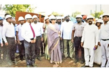 Colombo Mayor Rosy Senanayake and Deputy Mayor M.T.M. Iqbal inspect the Kerawalapitiya waste disposal plant which is to be commissioned in January. Inset: Ongoing construction at the plant. Pictures by Colombo Central Group Corr.