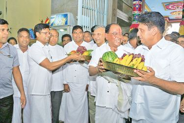 NDF Presidential candidate Minister Sajith Premadasa received blessings at the Selva Vinayagar Kovil on Tuesday. Here, Trustee of the Kovil G. Krishnamoorthy receiving the Minister. Picture by Sunil Gunawardena, Kundasale Group Corr.