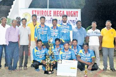 The victorious Thirukkovil Udayasooriyan SC cricket team with the guests and their trophies.