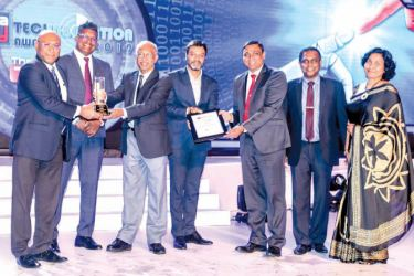 "NDB Director and GCEO Dimantha Seneviratne receives the Gold award for ""Bank of the Year for Excellence in Customer Convenience from H. A. Karunaratne, Deputy Governor Central Bank"