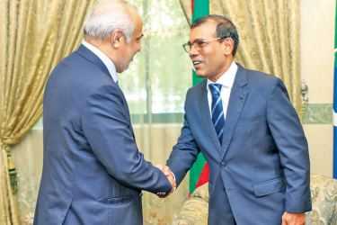 Speaker of the Maldivian Parliament and former President Mohamed Nasheed greeting City Planning, Water Supply and Higher Education Minister and SLMC leader Rauff Hakeem at the Maldivian Parliament building on Wednesday.