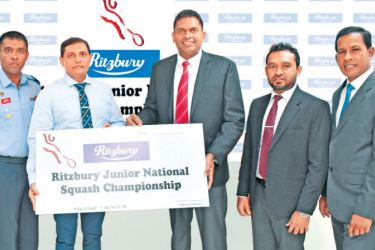 Presenting the sponsorship of the '30th Ritzbury Junior National Squash Championship' is Nilupul de Silva,General Manager, Marketing, CBL Foods International (Pvt) Ltd (center right) to Ajith Abeysekera Air Commodore (Rtd), president of Sri Lanka Squash (center left). Also pictured are officials from CBL and Sri Lanka Squash Federation.